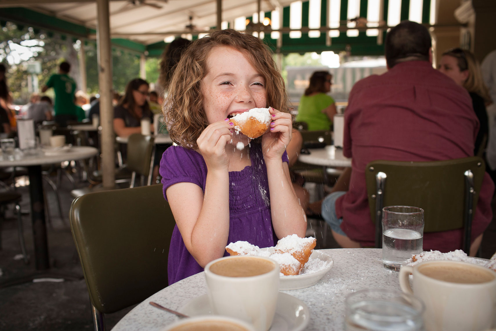 Callie Hirsch eating beignets at Cafe