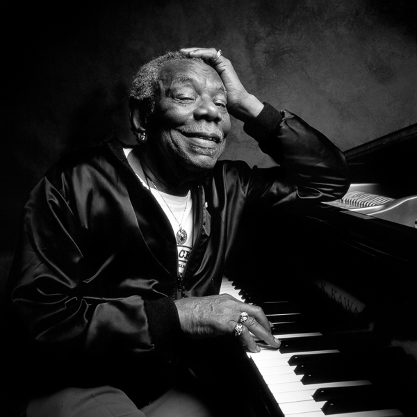 Champion Jack Dupree portrait at piano, black & white