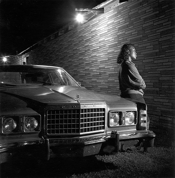 Jeanetta Davis leaning on car, Slim