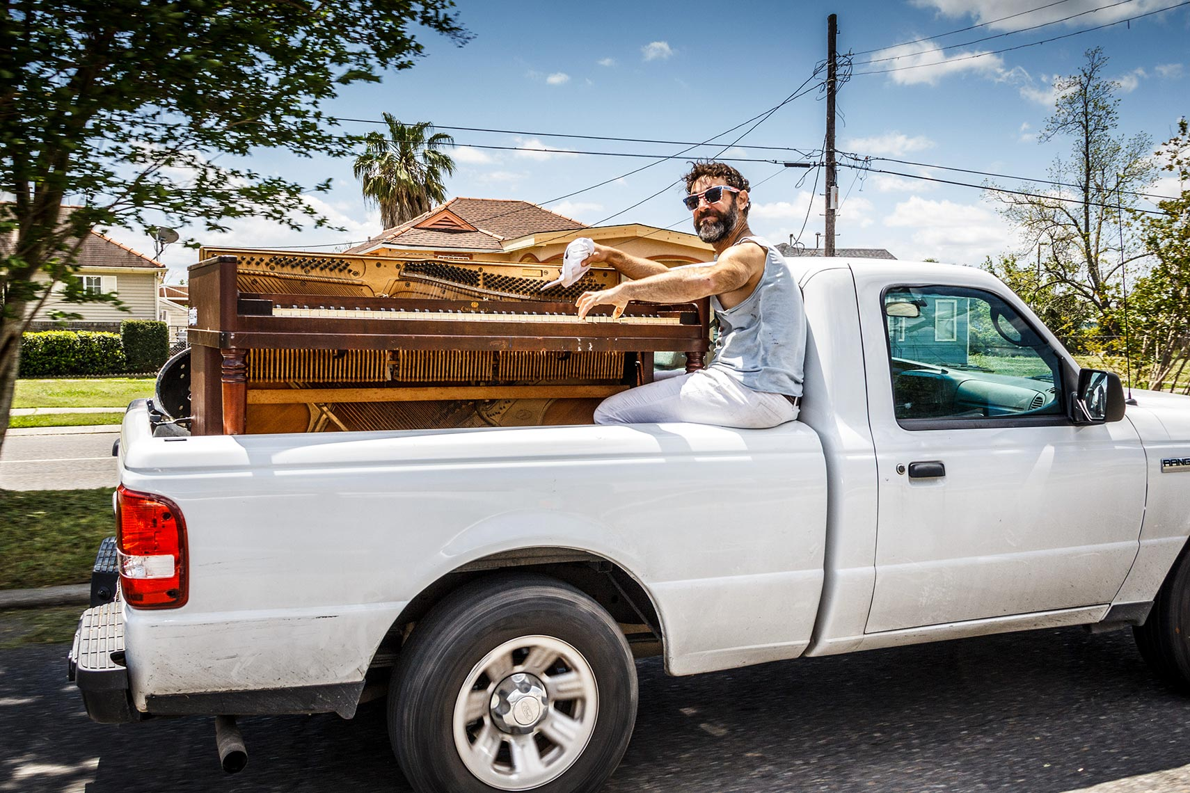 Piano & Player In Truck Bed